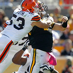 Pittsburgh Steelers quarterback Ben Roethlisberger just gets rid of the ball as he is hit by Cleveland Browns linebacker Matt Roth (53) and defensive tackle Shaun Rogers (92) in the second q …