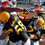 Pittsburgh Steelers quarterback Ben Roethlisberger (7) eludes Cleveland Brown defender Shaun Rogers, left, who is blocked by Steelers' Chris Kemoeatu (68) in the second quarter of an NFL foo …