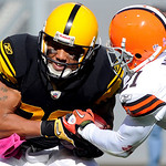 Pittsburgh Steelers receiver Hines Ward (86) pulls in a pass from quarterback Ben Roethlisberger as Cleveland Browns cornerback Eric Wright (21) defends in the third quarter of an NFL footba …