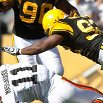 Pittsburgh Steelers linebacker James Harrison (92) hits Cleveland Browns wide receiver Mohamed Massaquoi (11) after Massaquoi tried to catch a pass in the second quarter of an NFL football g …