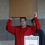 Cleveland Browns linebacker Matt Roth carries his belongings from the NFL team's headquarters Monday, Jan. 3, 2011, in Berea, Ohio. After two 5-11 seasons head coach Eric Mangini was fired e …