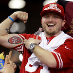 A San Francisco 49ers fan shows off his tattoo  after the NFL football NFC Championship game against the Atlanta Falcons Sunday, Jan. 20, 2013, in Atlanta. The 49ers won 28-24 to advance to  …
