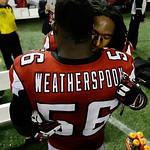 Atlanta Falcons' Dunta Robinson hugs Sean Weatherspoon after the NFL football NFC Championship game against the San Francisco 49ers Sunday, Jan. 20, 2013, in Atlanta. The 49ers won 28-24 to  …