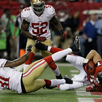 Atlanta Falcons' Tony Gonzalez catches a 10-yard touchdown pass in front of San Francisco 49ers' Donte Whitner (31) during the first half of the NFL football NFC Championship game Sunday, Ja …