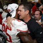San Francisco 49ers head coach Jim Harbaugh hugs Vernon Davis after the NFL football NFC Championship game against the Atlanta Falcons Sunday, Jan. 20, 2013, in Atlanta. The 49ers won 28-24  …