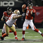 Atlanta Falcons quarterback Matt Ryan (2) tries to get away from San Francisco 49ers' Isaac Sopoaga during the second half of the NFL football NFC Championship game Sunday, Jan. 20, 2013, in …
