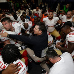 San Francisco 49ers head coach Jim Harbaugh talks to his players after the NFL football NFC Championship game against the Atlanta Falcons Sunday, Jan. 20, 2013, in Atlanta. The 49ers won 28- …