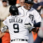 Detroit Tigers' Carlos Guillen (9) celebrates with teammate Austin Jackson, right, after scoring the winning run on wild pitch by Cleveland Indians' Chris Perez in the ninth inning of a base …