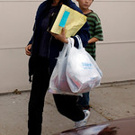 Mayumi Heene, front, and her son, Ryo, 9, return to the family's home in Fort Collins,, Colo., late on Sunday, Oct. 18, 2009.  The story that 6 year old Falcon Heene had floated away in a gi …