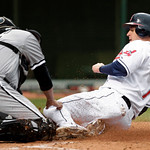 Cleveland Indians' Matt LaPorta, right, is tagged out at the plate by Chicago White Sox catcher Ramon Castro during the sixth inning in the first game of a baseball doubleheader on Wednesday …