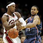 Charlotte Bobcats' D.J. Augustin, right, puts pressure on Cleveland Cavaliers' Daniel Gibson in the second quarter of a preseason NBA basketball game, Tuesday, Oct. 6, 2009, in Cleveland. (A …