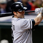 Chicago White Sox's Paul Konerko singles off Cleveland Indians relief pitcher Justin Masterson to drive in a run in the sixth inning in the second game of a baseball doubleheader Wednesday,  …