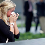 Kayla Fallon, daughter of William Fallon who perished in Tower One when she was 8 years old, cries while visiting the 9/11 Memorial during ceremonies marking the 12th anniversary of the 9/11 …