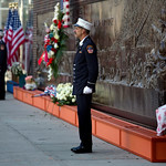 An FDNY firefighter stands at attention at 10:03 a.m. at a firefighter's memorial near One World Trade Center on Wednesday on the 12th anniversary of the Sept. 11, 2001 attacks. This moment  …