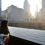 Showkatara Sharif, of Chantilly, Va., stands next to the engraving of her daughter's name, Shakila Yasmin, at the edge of the North Pool at the 9/11 Memorial during a ceremony marking the 12 …