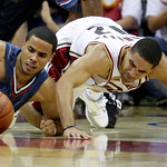 Charlotte Bobcats' D.J. Augustin, left, and Cleveland Cavaliers' Andre Barrett battle for a loose ball in the fourth quarter of a preseason NBA basketball game, Tuesday, Oct. 6, 2009, in Cle …