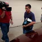 Richard Heene, center, returns to the family's home in Fort Collins,, Colo., late on Sunday, Oct. 18, 2009. The story that 6 year old Falcon Heene had floated away in a giant helium balloon  …
